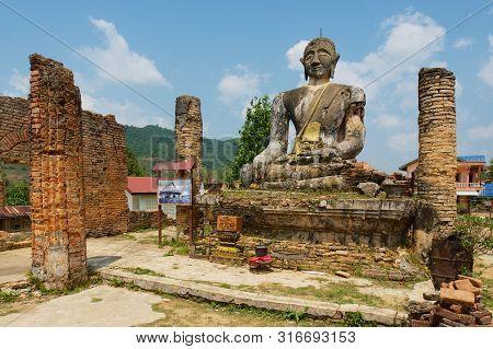 Phonsavan, Laos - April 19, 2012: Ruin Of The Wat Phia Wat Temple With Damaged Buddha Statue In Phon