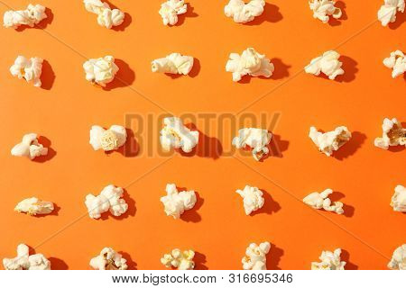 Flat Lay Composition With Popcorn On Orange Background, Closeup