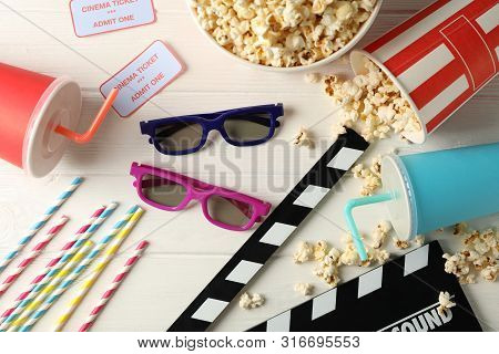 Flat Lay. 3D Glasses, Buckets With Popcorn, Tickets, Clapperboard, Drink, On White Wood Background