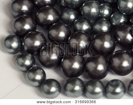 Black Pearls Texture. Close Up View, Selective Focus Image