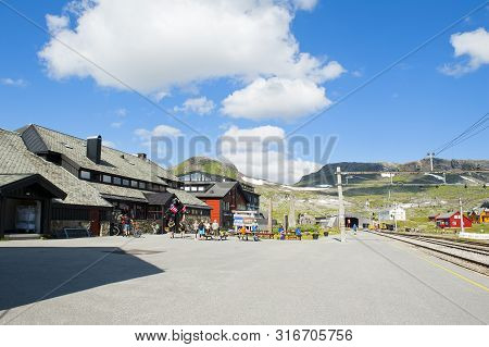 Finse, Norway - July 28, 2019: Tourists, Hotel Finse 1222 And Railway Station In Finse