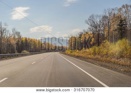 Amazing View With Colorful Autumn Forest With Asphalt Mountain Road. Beautiful Landscape With Empty