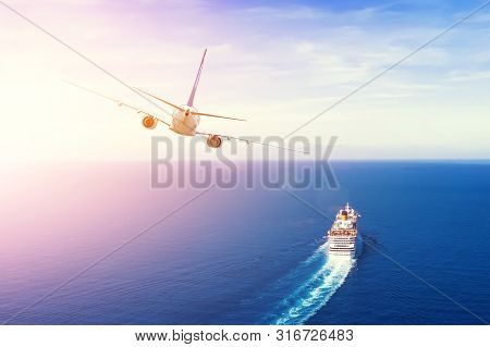 Cruise Ship Goes Into The Open Sea, Plane Flies Into The Sky Horizon In The Evening At Sunset. Trave