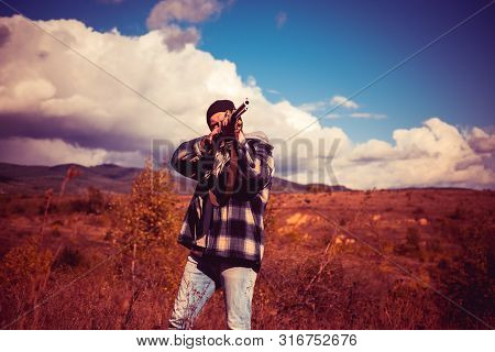 Hunter With Shotgun Gun On Hunt. Autumn Hunting Season. Hunter In The Fall Hunting Season