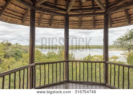 Kruger National Park, South Africa - May 11, 2019: A Shaded Viewing Deck In The Mopani Rest Camp Of