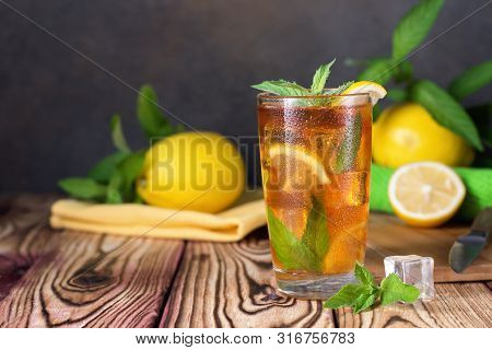 Glass Of Iced Tea With Mint And Lemon. Cold Drink. Rustic Style