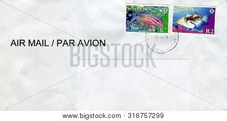 GOMEL, BELARUS - AUGUST 08, 2019: Old envelope which was dispatched from Seychelles to Gomel, Belarus, August 08, 2019.