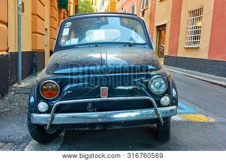 Genoa (Genova), Italy - June 30, 2019:  Blue classic car Fiat 600 in the old street in Genoa. Front view