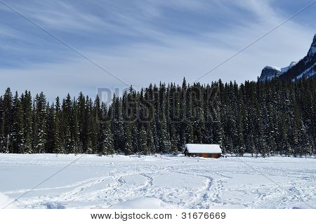 Boat house on frozen lake