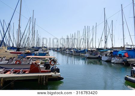 Sailboat Harbor, Many Beautiful Moored Sail Yachts In The Sea Port, Modern Water Transport