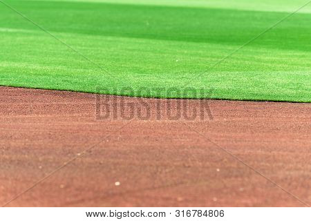 Clean And Perfect Line Between Baseball Field Infield Dirt And Outfield Grass.
