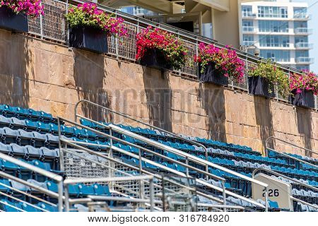 Outfield Bleacher Seating In Neat Rows At Baseball Stadium Located In The Middle Of Downtown City.