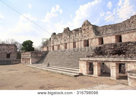 Ruins of royal complex near to ancient Mayan pyramid of the Magician in Uxmal, Yucatan, Mexico. UNESCO world heritage site