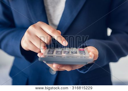 Close-up Of Business Accountant Financial Using Calculator For Estimated Tax Earning Account, Entrep