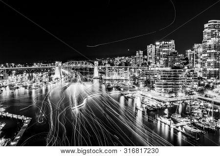 Vancouver, Canada - August 3, 2019: Famous Burrard Street Bridge At Night.