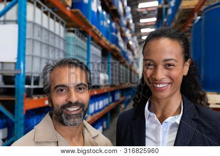 Female manager standing together in warehouse. This is a freight transportation and distribution warehouse. Industrial and industrial workers concept