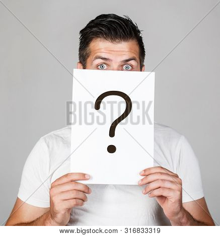 Question Mark, Symbol. Pensive Male. Man A Question. Doubtful Man Holding Question Mark. Problems An