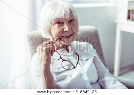 Close Up Of Beautiful Elderly Lady With Facial Wrinkles Smiling Broadly