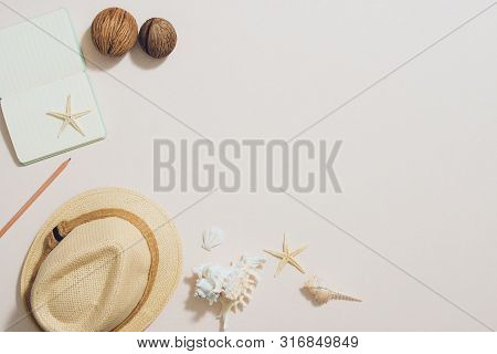Colorful Summer Holidays Fashion Flat Lay - Straw Hat, Camera, Sunglass, Sea Shells On Ligh Backgrou