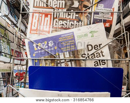 Strasbourg, France - May 25, 2019: Man Hand Pov Reading Taz At Press Kiosk Newspaper Featuring Eu Ne