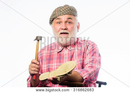 poster of Shoe repair shop. Senior master with hammer repairing shoe. Handmade concept. Designing shoe. Craftsman laborer worker. Custom made shoes. Man bearded handyman working with tools white background