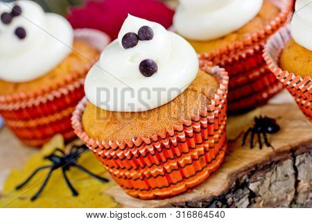 Halloween Ghost Cupcakes , Homemade Sweet Pumpkin Cakes With Cream Cheese Frosting Shaped Funny Ghos