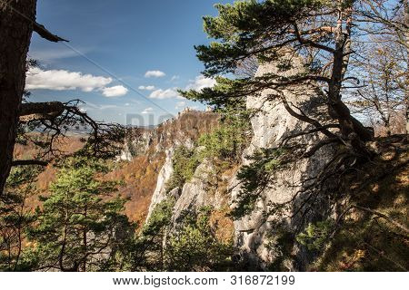 Autumn Sulovske Skaly Mountains From View Point Near Rohac Hill With Rocks, Colorful Forest And Blue