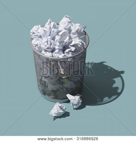 Trash Can Filled With Crumpled Paper, Frustration And Rejection Concept