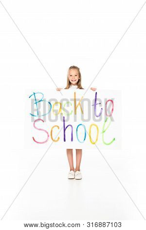 Cute Schoolgirl Holding Placard With Back To Shool Inscription On White Background