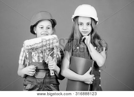 Kids choosing paint colour for their new room. Kids girls planning renovation. Children sisters run renovation their room. Amateur renovation. Sisters renovating home. Home improvement activities poster