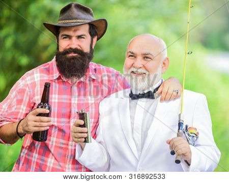 Fishing And Drinking Beer. Bearded Man And Elegant Businessman Fishing Together. Cheers. Men Relaxin
