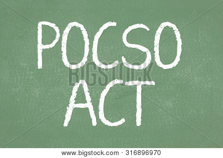 Pocso Act Is A Law To Protect The Children From Sexual Offences In India Written On Green Chalkboard
