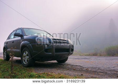 Mizhhirya, Ukraine - Oct 14, 2018: Hyundai Tucson Suv On The Old Cracked Countryside Road Side In Fo