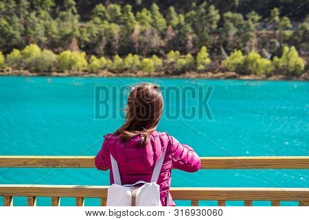 Young Woman Traveler Looking Beautiful Nature At Blue Moon Valley In China, Travel Lifestyle Concept