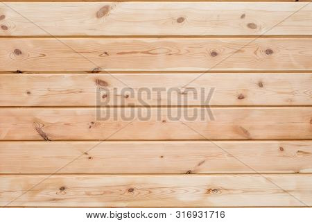 Wood Glued timber plank background. Wooden construction glued laminated timber in the wall of the house. Glued beams texture. Natural pattern pine wood background. poster