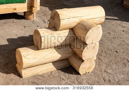 Construction Of The Wooden House From Round Logs. Blockhouse Logs Example, Element In Store. Corner