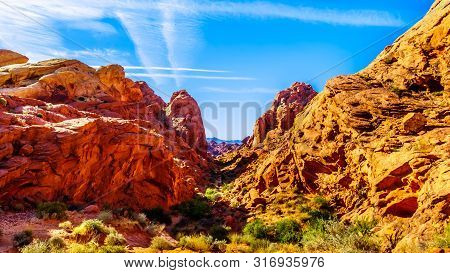 Red Aztec Sandstone Mountains At Sunrise On The Rainbow Vista Trail In The Valley Of Fire State Park
