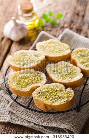 Fresh Homemade Garlic Bread, Slices Of Baguette Seasoned With Garlic, Oregano, Salt, Pepper And Oliv