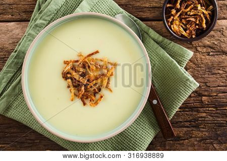 Fresh Homemade Cream Of Potato Soup In Bowl Garnished With Crispy Onion Strings, Photographed Overhe