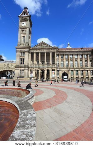 Birmingham, Uk - April 19, 2013: People Visit Chamberlain Square In Birmingham. Birmingham Is The Mo