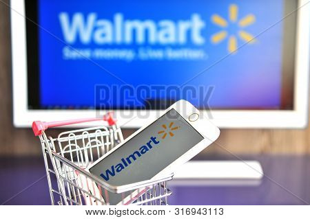Walmart Logo In Mobile Phone And Monitor.