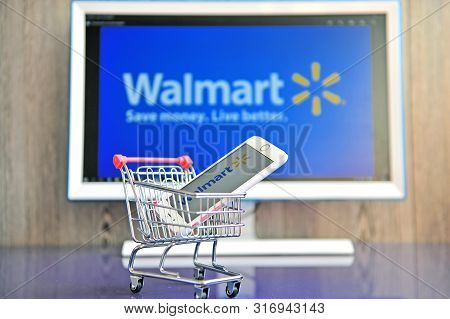 Mobile Phone And Computer Screen With Logo Of Walmart Company