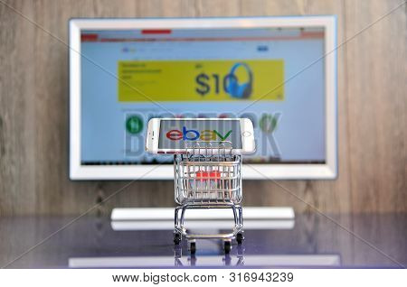 Mobile Phone In Shopping Cart And Computer Monitor With Logo Of Ebay