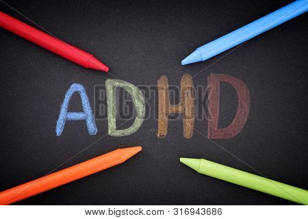 Adhd. Abbreviation Adhd On Black Background. Close Up. Adhd Is Attention Deficit Hyperactivity Disor