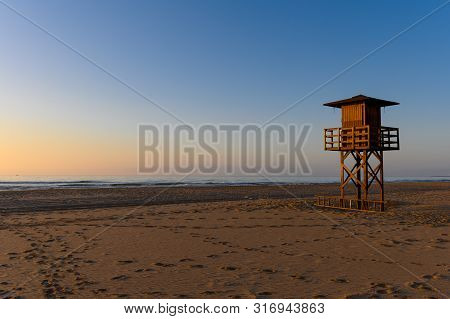 Stock Picture Of A Lifeguard Watchtower In Early Morning Sun, At Cullera Beach In Spain.