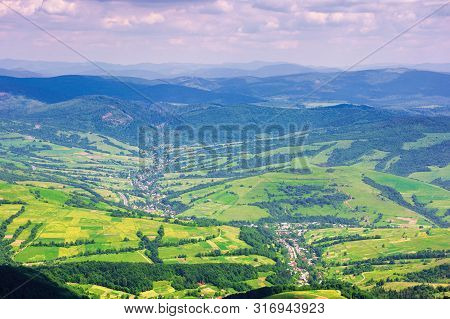 View From A Mountain Top In To The Green Valley. Beautiful Summer Landscape Of Bilasovytsya Village,