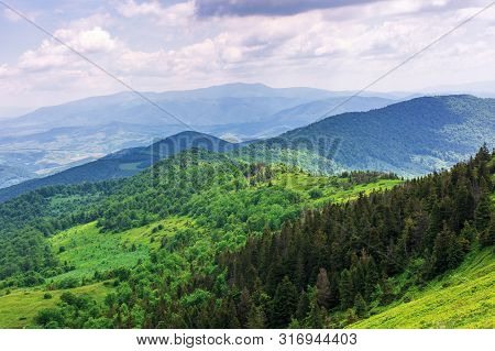 Beautiful Summer Mountain Landscape. Forested Hill Rolling In To The Distance. Borzhava Ridge On The