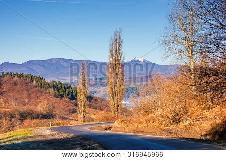 Road Winding In Mountains In Autumn. Beautiful Autumn Scenery In Morning Light. Wonderful November W
