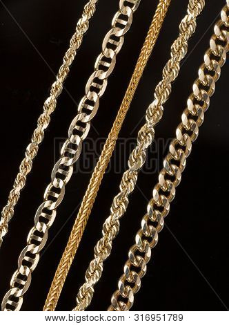 Five Gold Chain Necklaces Close Up