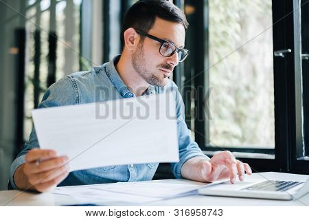 Serious Pensive Thoughtful Focused Young Casual Business Accountant Bookkeeper In Office Looking At